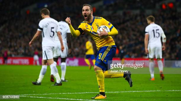 Gonzalo Higuain of Juventus celebrates after scoring the equalising goal during the UEFA Champions League Round of 16 Second Leg match between...