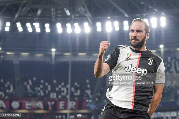 Gonzalo Higuain of Juventus celebrates after scoring the goal of 1-0 during the UEFA Champions League group D match between Juventus and Bayer...