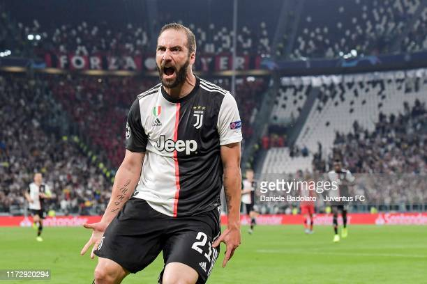 Gonzalo Higuain of Juventus celebrates after scoring the goal of 10 during the UEFA Champions League group D match between Juventus and Bayer...