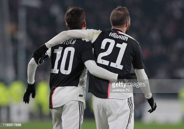 Gonzalo Higuain of Juventus celebrates after scoring the opening goal with teammate Paulo Dybala during the Coppa Italia match between Juventus and...
