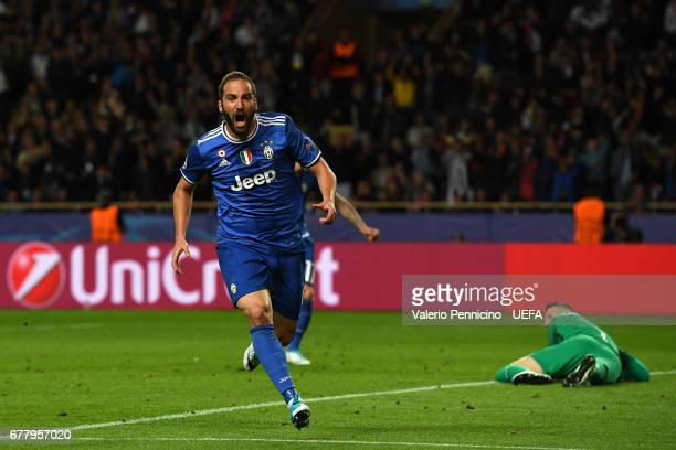 Gonzalo Higuain of Juventus celebrates after scoring the opening goal during the UEFA Champions League Semi Final first leg match between AS Monaco v...
