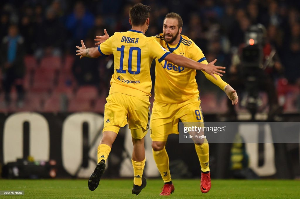 Gonzalo Higuain of Juventus celebrates after scoring the opening goal during the Serie A match between SSC Napoli and Juventus at Stadio San Paolo on December 1, 2017 in Naples, Italy.