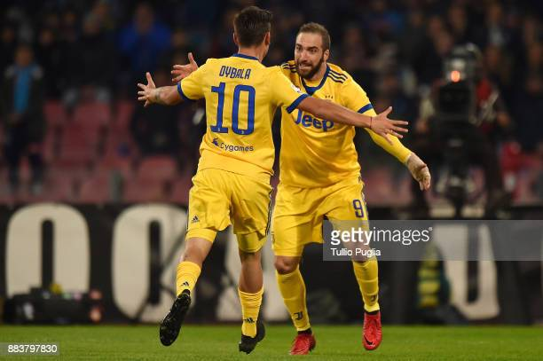 Gonzalo Higuain of Juventus celebrates after scoring the opening goal during the Serie A match between SSC Napoli and Juventus at Stadio San Paolo on...