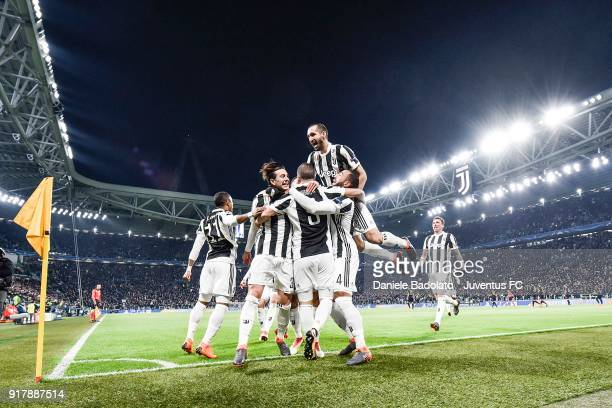 Gonzalo Higuain of Juventus celebrates his first goal with Juventus players during the UEFA Champions League Round of 16 First Leg match between...