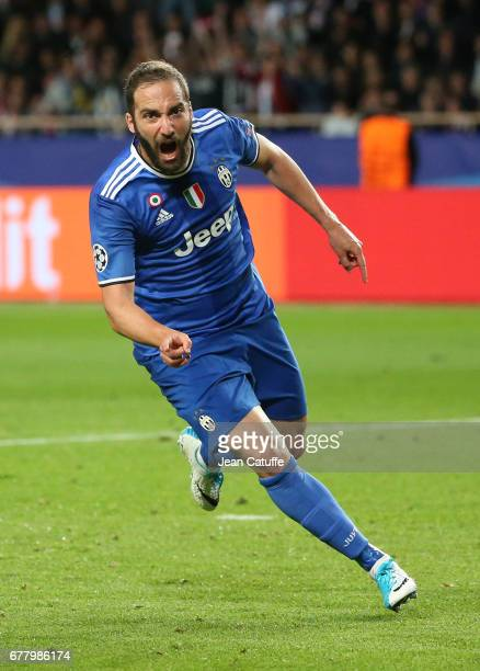 Gonzalo Higuain of Juventus celebrates his goal during the UEFA Champions League semi final first leg match between AS Monaco and Juventus Turin at...