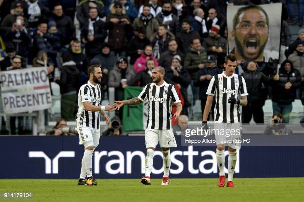 Gonzalo Higuain of Juventus celebrates his goal togheter Stefano Sturaro of Juventus during the serie A match between Juventus and US Sassuolo on...