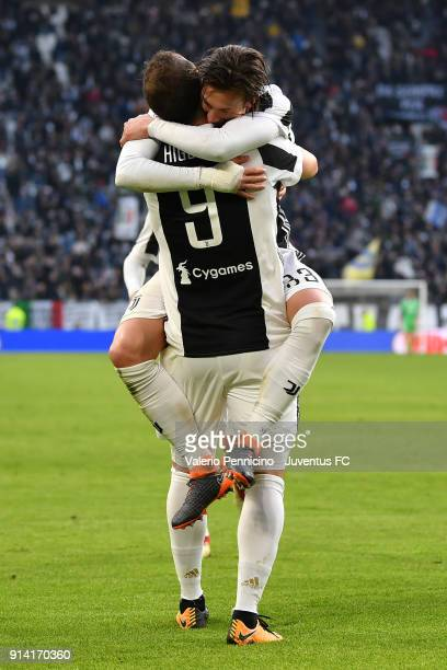 Gonzalo Higuain of Juventus celebrates his goal with Federico Bernardeschi of Juventus during the serie A match between Juventus and US Sassuolo on...