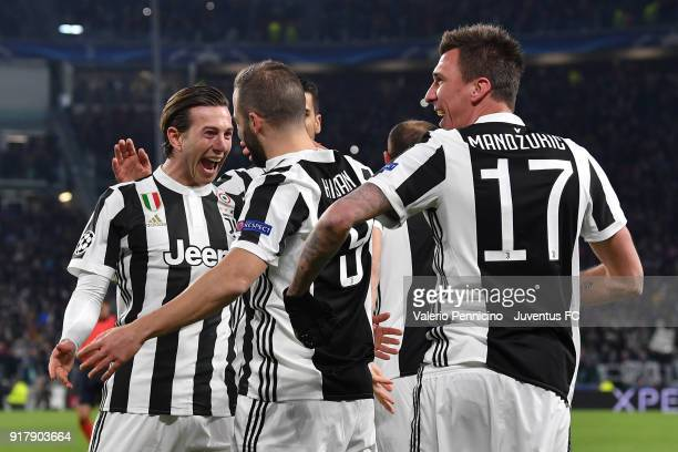 Gonzalo Higuain of Juventus celebrates his second goal with Federico Bernardeschi and Mario Mandzukic during the UEFA Champions League Round of 16...
