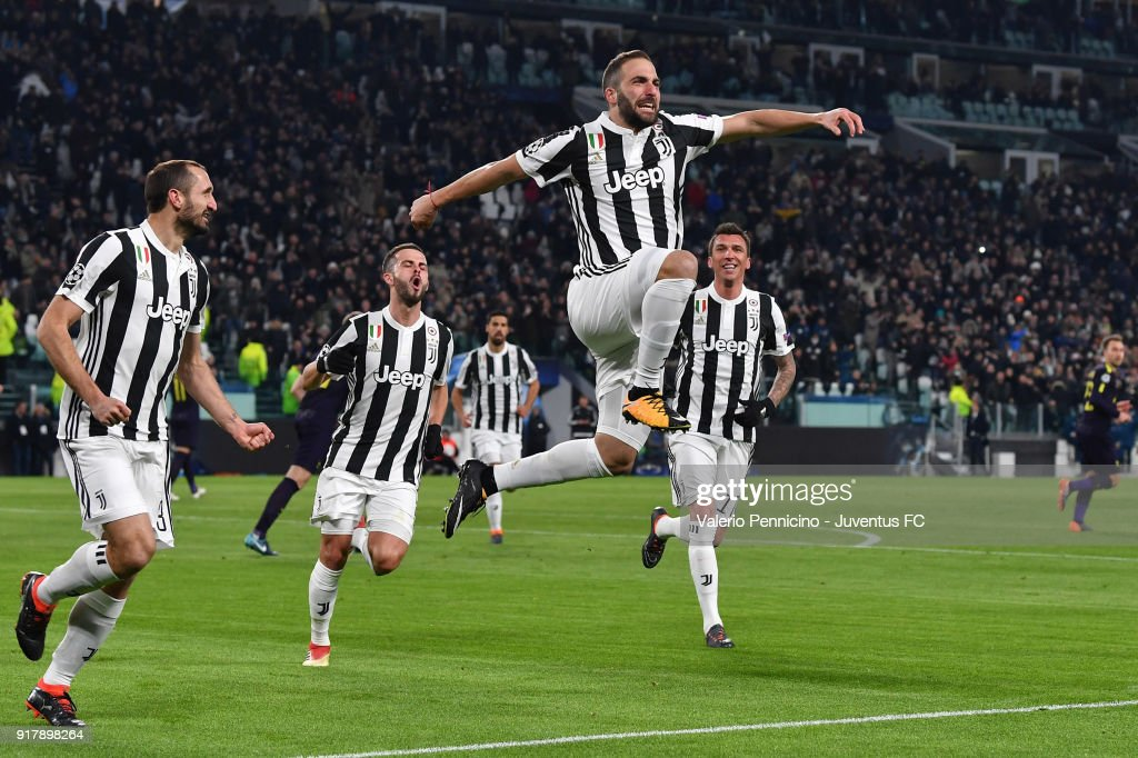 Gonzalo Higuain of Juventus celebrates his second goal with Giorgio Chiellini, Miralem Pjanic and Mario Mandzukic during the UEFA Champions League Round of 16 First Leg match between Juventus and Tottenham Hotspur at Allianz Stadium on February 13, 2018 in Turin, Italy.