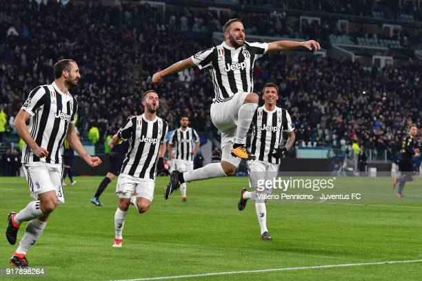 Gonzalo Higuain of Juventus celebrates his second goal with Giorgio Chiellini Miralem Pjanic and Mario Mandzukic during the UEFA Champions League...