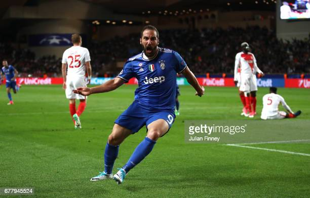 Gonzalo Higuain of Juventus celebrates scoring his sides first goal during the UEFA Champions League Semi Final first leg match between AS Monaco v...