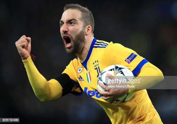 Gonzalo Higuain of Juventus celebrates scoring their 1st and equalising goal during the UEFA Champions League Round of 16 Second Leg match between...