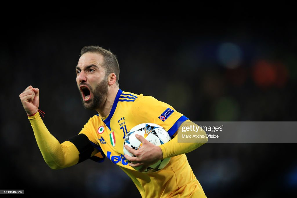 Gonzalo Higuain of Juventus celebrates scoring their 1st goal during the UEFA Champions League Round of 16 Second Leg match between Tottenham Hotspur and Juventus at Wembley Stadium on March 7, 2018 in London, United Kingdom.