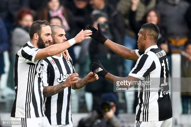 Gonzalo Higuain of Juventus celebrates the goal of 7 0 togheter Alex Sandro and Stefano Sturaro of Juventus during the serie A match between Juventus...