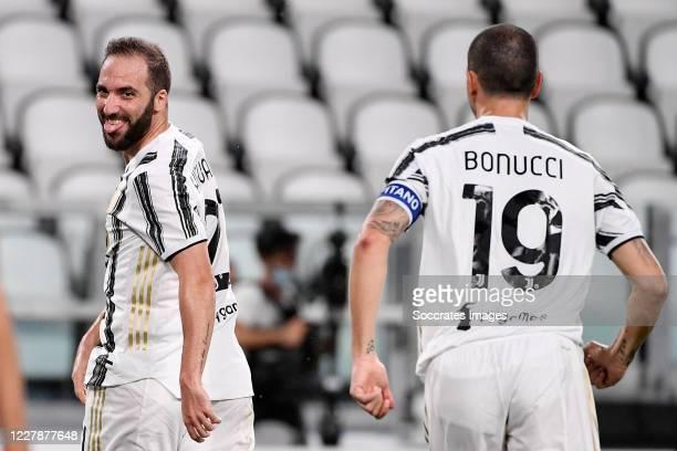 Gonzalo Higuain of Juventus celebrates with Leonardo Bonucci of Juventus during the Italian Serie A match between Juventus v AS Roma at the Allianz...