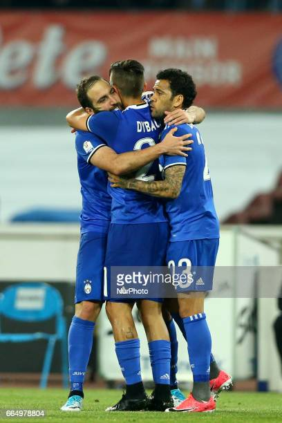 Gonzalo Higuain of Juventus celebrating with Paulo Dybala and Daniel Alves of Juventus during the TIM Cup match between SSC Napoli and Juventus FC at...
