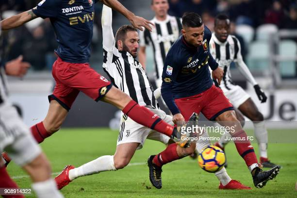 Gonzalo Higuain of Juventus competes for the ball with Armando Izzo of Genoa CFC during the Serie A match between Juventus and Genoa CFC on January...