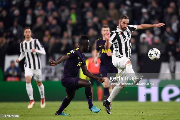 Gonzalo Higuain of Juventus competes for the ball with Davinson Sanchez of Tottenham Hotspur FC during the UEFA Champions League Round of 16 First...