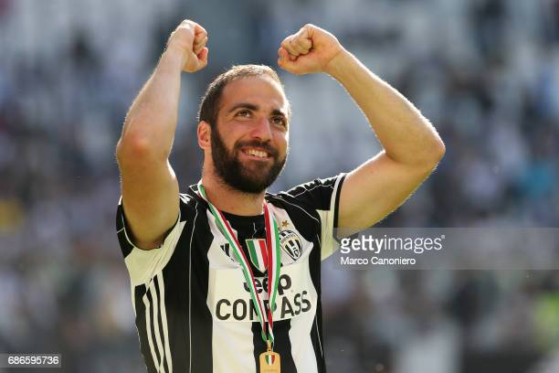 Gonzalo Higuain of Juventus FC celebrate the victory of Italian Serie A after the match between Juventus Fc and Fc Crotone