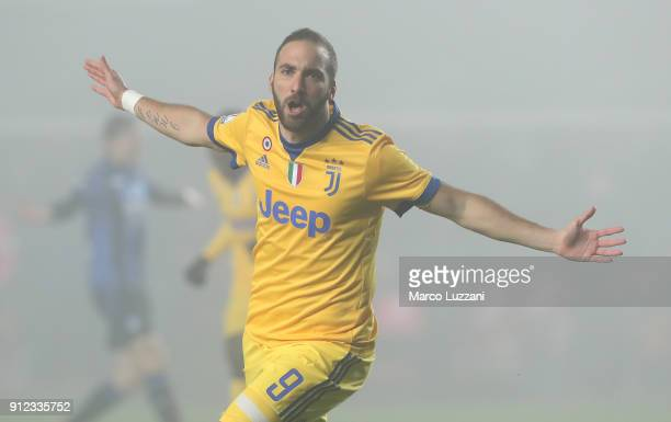 Gonzalo Higuain of Juventus FC celebrates after scoring the opening goal during the TIM Cup match between Atalanta BC and Juventus at Stadio Atleti...