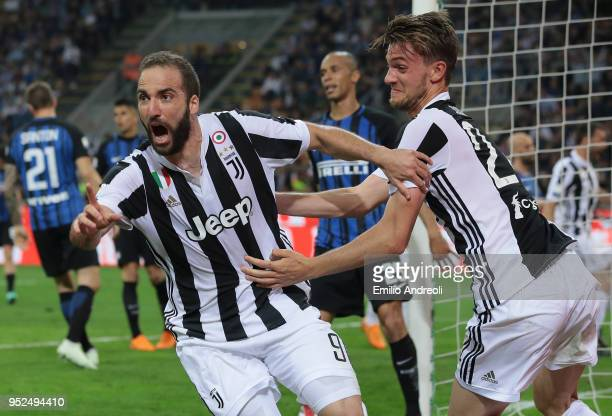 Gonzalo Higuain of Juventus FC celebrates his goal with his teammate Daniele Rugani during the serie A match between FC Internazionale and Juventus...
