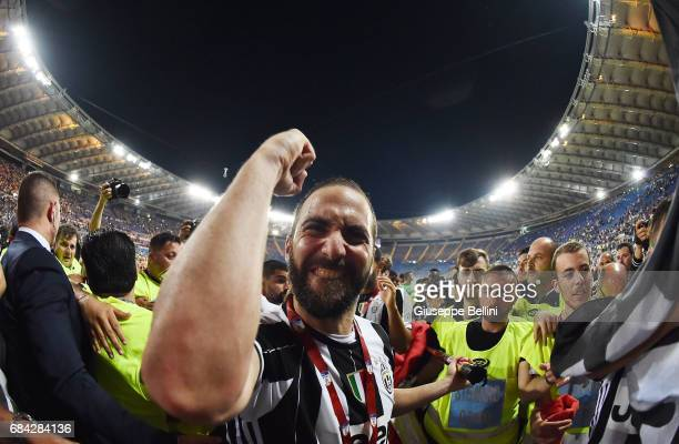 Gonzalo Higuain of Juventus FC celebrates the victory after the TIM Cup Final match between SS Lazio and Juventus FC at Olimpico Stadium on May 17...