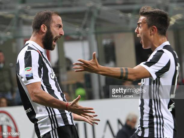 Gonzalo Higuain of Juventus FC celebrates with his teammate Paulo Dybala after scoring the opening goal during the Serie A match between AC Milan and...