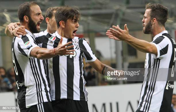 Gonzalo Higuain of Juventus FC celebrates with his teammates Paulo Dybala and Miralem Pjanic after scoring the opening goal during the Serie A match...