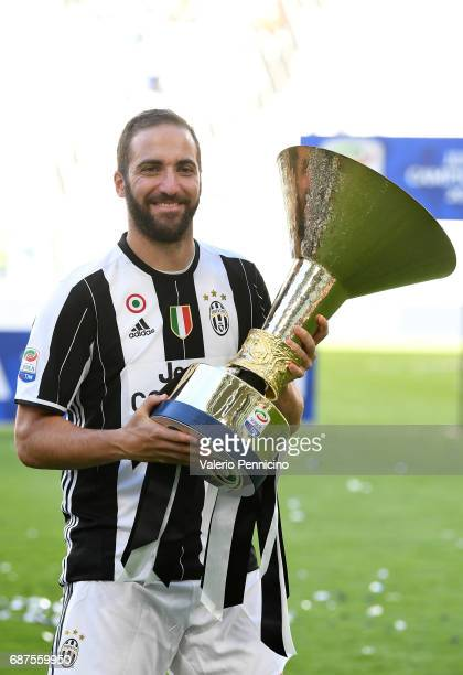 Gonzalo Higuain of Juventus FC celebrates with the trophy after the beating FC Crotone 30 to win the Serie A Championships at the end of the Serie A...