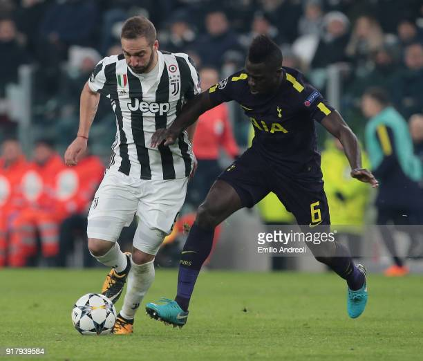 Gonzalo Higuain of Juventus FC competes for the ball with Davinson Sanchez of Tottenham Hotspur during the UEFA Champions League Round of 16 First...