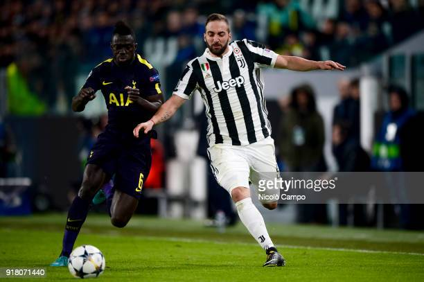 Gonzalo Higuain of Juventus FC competes for the ball with Davinson Sanchez of Tottenham Hotspur FC during the UEFA Champions League Round of 16 First...