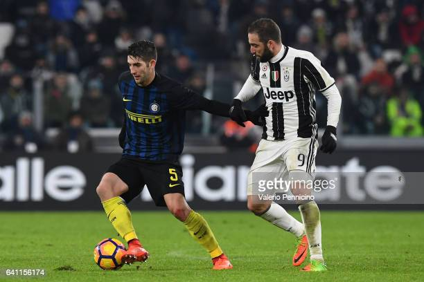 Gonzalo Higuain of Juventus FC competes with Roberto Gagliardini of FC Internazionale during the Serie A match between Juventus FC and FC...