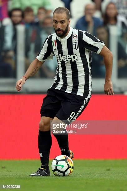 Gonzalo Higuain of Juventus FC in action during the Serie A match between Juventus and AC Chievo Verona on September 9 2017 in Turin Italy