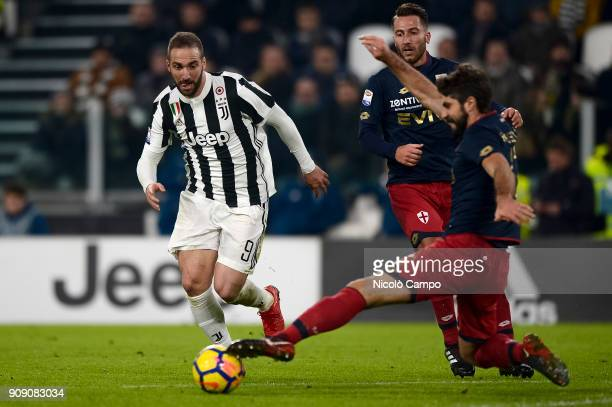Gonzalo Higuain of Juventus FC is tackled by Luca Rossettini of Genoa CFC during the Serie A football match between Juventus FC and Genoa CFC...