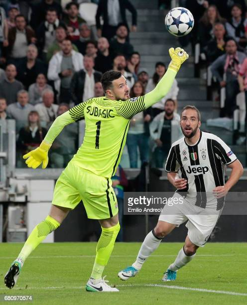 Gonzalo Higuain of Juventus FC kicks the ball and Danijel Subasic of AS Monaco makes a save during the UEFA Champions League Semi Final second leg...