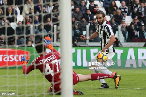 Gonzalo Higuain of Juventus FC scores a goal during the serie A match between Juventus and US Sassuolo on February 4 2018 in Turin Italy