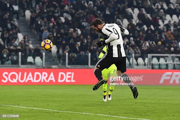 Gonzalo Higuain of Juventus FC scores his second goal during the Serie A match between Juventus FC and Bologna FC at Juventus Stadium on January 8...