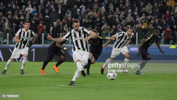 Gonzalo Higuain of Juventus FC scores his second goal on a penalty kick during the UEFA Champions League Round of 16 First Leg match between Juventus...
