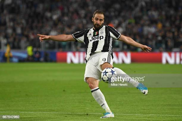 Gonzalo Higuain of Juventus has a shot during the UEFA Champions League Quarter Final first leg match between Juventus and FC Barcelona at Juventus...