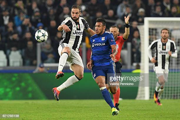Gonzalo Higuain of Juventus in action against Corentin Tolisso of Olympique Lyonnais during the UEFA Champions League Group H match between Juventus...