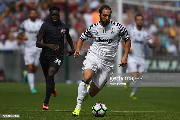 Gonzalo Higuain of Juventus in action during the PreSeason Friendly between West Ham United and Juventus at London Stadium on August 7 2016 in London...