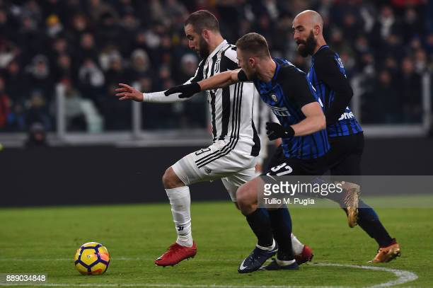 Gonzalo Higuain of Juventus in challenged by Milan Skriniar and Borja Valero of Internazionale during the Serie A match between Juventus and FC...