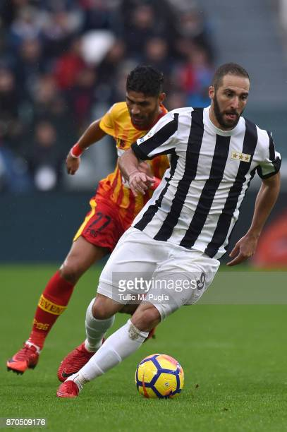 Gonzalo Higuain of Juventus is challenged by Achraf Lazaar of Benevento during the Serie A match between Juventus and Benevento Calcio on November 5...