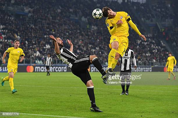 Gonzalo Higuain of Juventus is challenged by Mario Situm of GNK Dinamo Zagreb during the UEFA Champions League Group H match between Juventus and GNK...