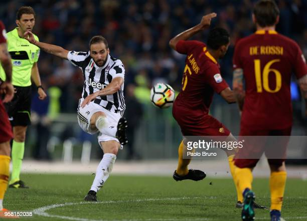 Gonzalo Higuain of Juventus kicks the ball during the Serie A match between AS Roma and Juventus at Stadio Olimpico on May 13 2018 in Rome Italy