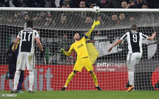 Gonzalo Higuain of Juventus misses a penalty kick as Hugo Lloris of Tottenham Hotspur attempts to save during the UEFA Champions League Round of 16...