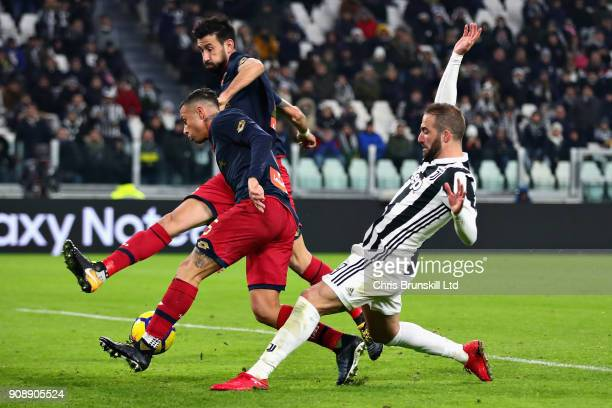 Gonzalo Higuain of Juventus Nicolas Spolli and Armando Izzo both of Genoa CFC in action during the Serie A match between Juventus and Genoa CFC at...