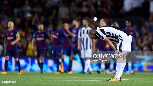 Gonzalo Higuain of Juventus reacts to Barcelona scoring their third goal during the UEFA Champions League Group D match between FC Barcelona and...