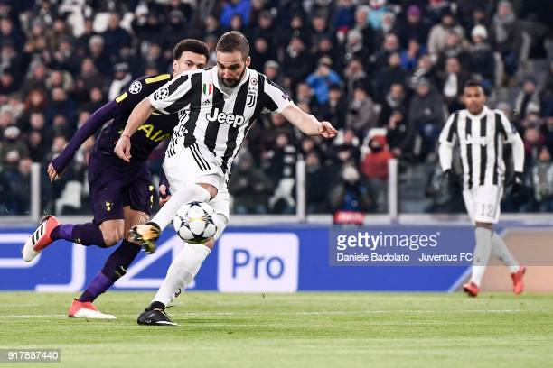 Gonzalo Higuain of Juventus scores his first goal during the UEFA Champions League Round of 16 First Leg match between Juventus and Tottenham Hotspur...