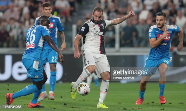 Gonzalo Higuain of Juventus scores his goal during the Serie A match between Juventus and SSC Napoli at Allianz Stadium on August 31 2019 in Turin...